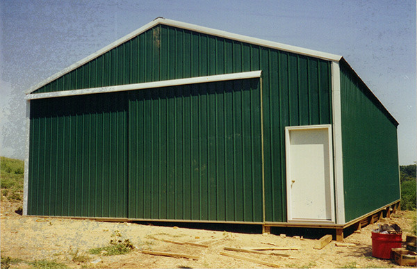 Pole Barn Sliding Door Green Walls Galvalume Roof And White Trim