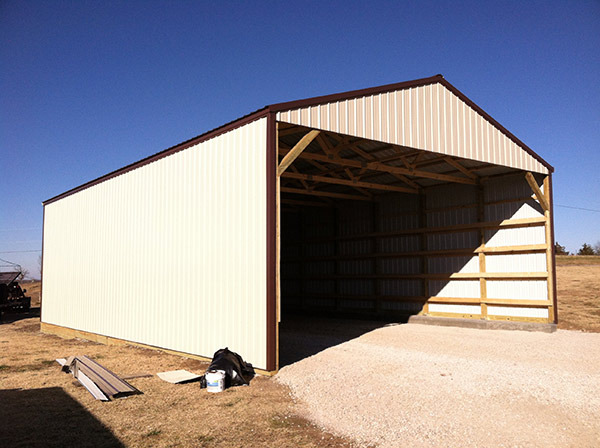 Pole Barn One End Open Light Stone Walls Brown Roof And Trim
